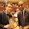 NEW YORK, USA – Nicholas Beck de Paiva (L) hands a copy of the GOOD WILL Sustainable Development magazine to Casey Gerald, Chief Executive Officer of MBAs Across America.