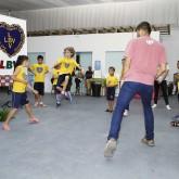 Florianópolis, SC —Durante entrega das cestas, as crianças atendidas fizeramuma apresentação de Taekwondo, sob a coordenação do professor Samuel Gomes, voluntário da LBV.