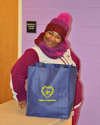 Parent of Oliver St. School in Newark, NJ happily receives food basket from LGW's Everlasting Christmas campaign