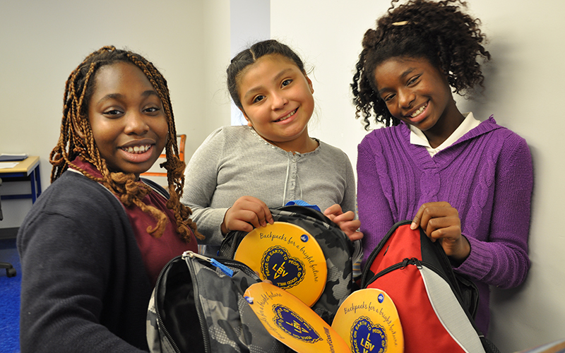 Students at the Lincoln Avenue School in Orange, New Jersey recieve school supplies to start the school year through the LGW's Backpacks for a Bright Future campaign.