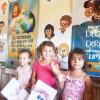 Assunção, Paraguai —Crianças participam, com sorriso no rosto, da abertura do 17º Fórum Internacional dos Soldadinhos de Deus, da LBV. =D