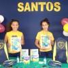 Santos, SP — A alegria estampada norosto das mesninas ao receberem o kit dematerial que ganharam da LBV.