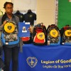 The Miles family receiving their new backpack from the LGW at the Oliver St. School in Newark.