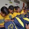 Campina Grande, PB - Curiosidade nos primeiros instantes e muita felicidade ao ver cada ítem do kit pedagógico!