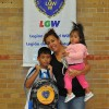 The Sinche family excited to have their new backpack provided by the LGW.