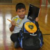 7-year-old Christopher opening his brand new backpack filled with all the materials he'll need this school year!