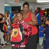 A mother and her son from the YMCA Shelter of Newark with their brand new backpack provided by the LGW's Backpacks for a Bright Future campaign.
