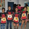 A group of kids from the YMCA Shelter of Newark with their new backpacks from the LGW's Backpacks for a Bright Future Campaign.