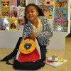 7-year-old Vitória excited to what's inside her new backpack!