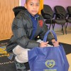 Children and families of Oliver St. School in Newark, NJ receive food baskets from LGW's Everlasting Christmas campaign.