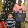 Mother and son happily receive food basket form LGW's Everlasting Christmas campaign.