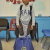 Third grade student from South St. School receives food basket from the LGW for his family's holiday meal