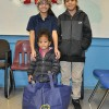 Siblings of South St. School in Newark, NJ receive food basket from the LGW's Everlasting Christmas campaign