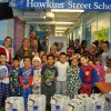 The children from Hawkin Street School all embrace the Christmas spirit with their care packages.