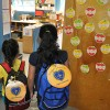 These girls are showing off Their new backpacks at the Oliver Street Elementary School in Newark.