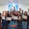 São José dos Campos/SP - Jovens reunidos com os certificados e livro do Irmão Paiva NettoA Missão dos Setenta e o
