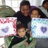 Registro, SP —Para a atendida Thais de Souza Motta e seus filhos,os cobertores chegaram em uma boa hora. Adona de casa é grata à LBV pelo imprescindível apoio.