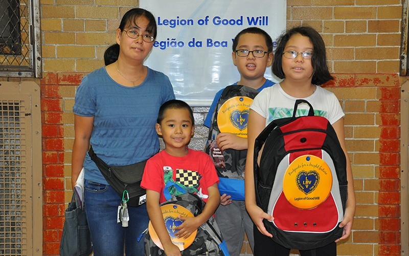 The Aguirre family is excited to have their brand new backpacks and supplies provided by the LGW!